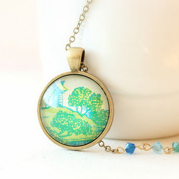 Cottage necklace in citrus and turquoise.  Sweet landscape image from vintage sheet music under glass with ombre crystals on chain