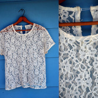 1960s. sheer white lace top with keyhole. m-l