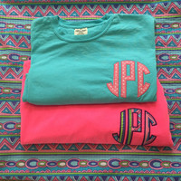 Custom fabric monogram Applique on a comfort color tshirt. Monogram is a circle applique font. Amazing fabric options available.