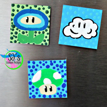 Super Mario Power up Refrigerator Magnets that are approximately 2x2 inches in size.