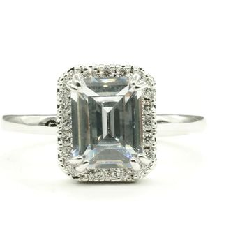 Emerald Cut Engagement Style Silvertone Fashion Ring in Halo Setting