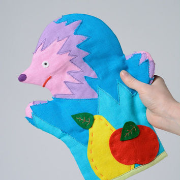 Funny puppet toy hand sewn of multi-colored fabrics Hedgehog