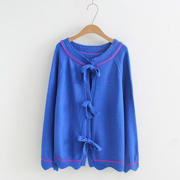 long sleeved back bow button hollow knit sweater