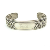 S. Kirk & Son Bracelet. Sterling Silver Floral Repoussé. Rose, Anemone. Narrow Cuff. Monogram 'Terri' Personalized Jewelry. Vintage 1950s