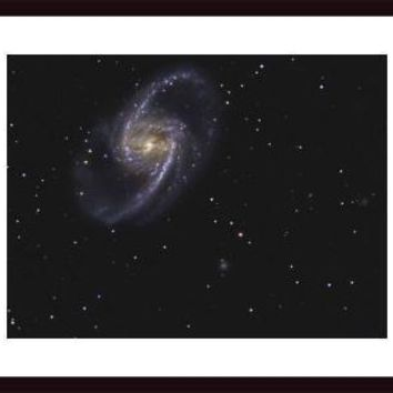 NGC 1365 is a barred spiral galaxy in the constellation Fornax., framed black wood, white matte