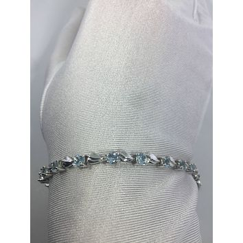 Handmade Genuine Blue Topaz Rhodium Finished 925 Sterling Silver Tennis Bracelet