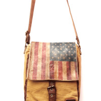 Ever feel like a minimalist? Sling The Slope over your shoulder with this antique color American Flag Print Small Messenger Bag print on leather Flap, brown leather piping, shoulder straps & stone washed canvas Small Messenger Bag. Unisex style and compact