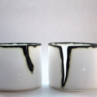 Abstract white vessel with English fine bone china with burnt finish