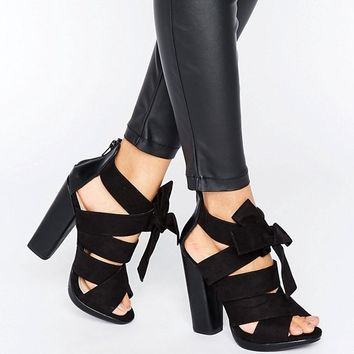 Little Mistress Black crossover strap peep toe heel with oversized bow. at asos.com