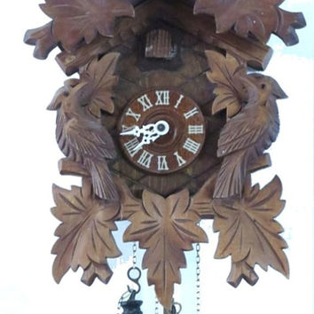 Black forest. Wood clock. Wooden clock. Wood wall clock. Mechanical clock. Cuckoo clock. Bird clock. Hand carved. Working.