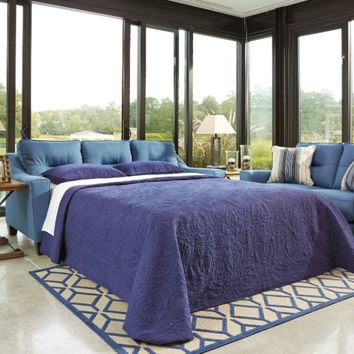 Ashley Furniture 66903-39 Forsan Nuvella collection blue fabric upholstered pull out sleeper sofa with memory foam mattress