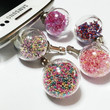 Glass Snow Globe Plug Plugy Earphone Jacks Phone by TheWabbitHole