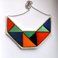Textile necklace embroidered geometric triangles in beautiful colors of green orange red blue and black