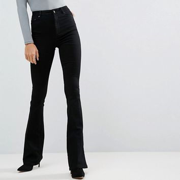 ASOS TALL Bell Flare Jeans In Clean Black With Pressed Crease at asos.com