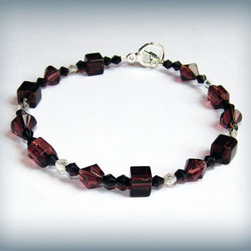 Plum Fool bracelet - purple, clear and black faceted beads with a toggle clasp