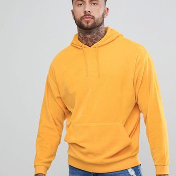 ASOS Oversized Hoodie In Yellow Velour at asos.com