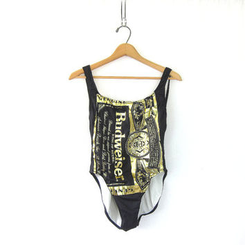 vintage one piece BUDWEISER swimsuit. black and gold swimming suit. women's bathing suit size 11-12