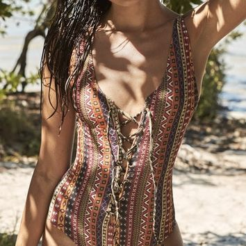 Capittana Honolulu | Luxury Lace Up One Piece