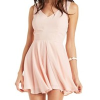 Pale Blush Layered Chiffon Skort Romper by Charlotte Russe