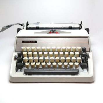 FREE SHIPPING 1970s Cream Adler Gabriele 25 Portable Manual Typewriter. Includes & Protective Carry Case. Made in Western Germany.