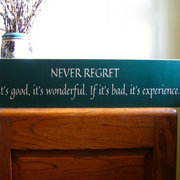 Never Regret.  If it's good, it's wonderful.  If it's bad it's experience custom wood sign.