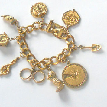 Vintage Charm Bracelet Monet Gold Tone w/ 9 by houseofheirlooms