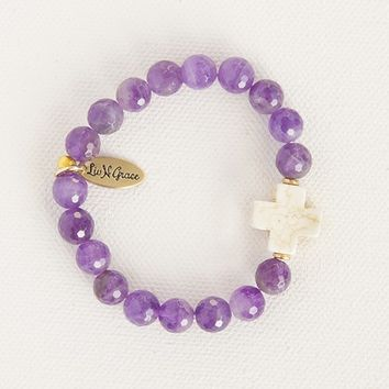 Liv•N•Grace  Amethyst  Beads  with  White  Cross  Bracelet  From  Natural  Life