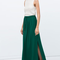 Long skirt with slits