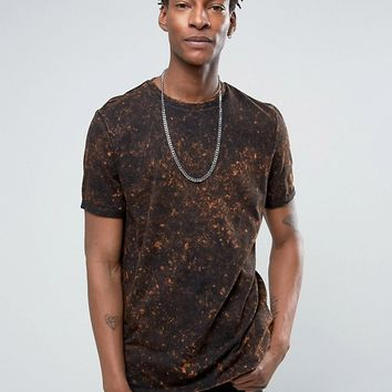 ASOS Longline T-Shirt With Bleach Spray Wash In Orange And Black at asos.com