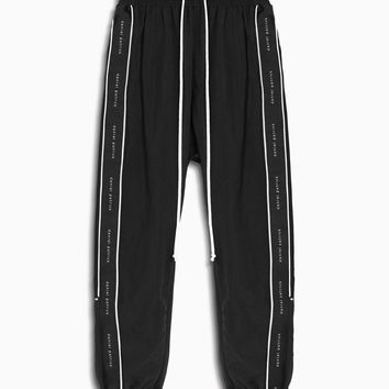 dp parachute track pant piping / black + ivory