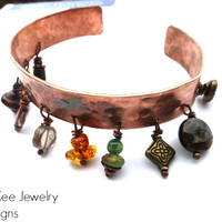 Hammered, textured, oxidized copper cuff with gemstone and metal charms. Copper jewelry.