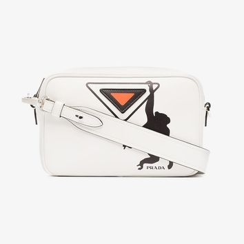 white, black and orange monkey leather camera bag