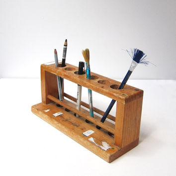 Vintage wooden school science lab test tube holder desk tidy with child graffiti