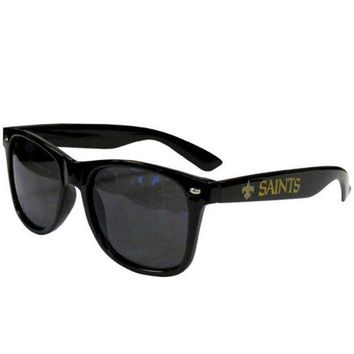DCCKG8Q NFL New Orleans Saints Beachfarer Sunglasses