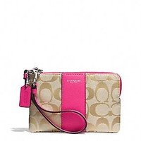LEGACY L-ZIP SMALL WRISTLET IN SIGNATURE FABRIC