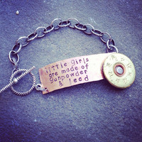 Hand Stamped Tag Girls are made of gunpowder and lead bracelet with shotgun shell accent