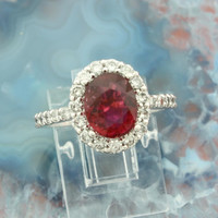 14k white gold rubellite tourmaline ladies engagement ring set with 0.84 carats of fine diamonds. Made in the USA!
