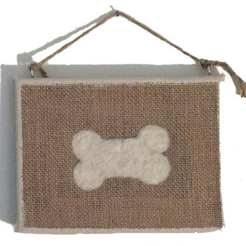 Needle felted dog bone on burlap frame