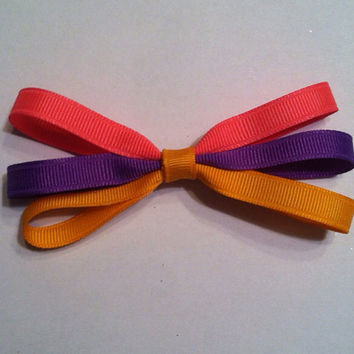 Rapunzel inspired bow by KaleighsBowsNThings on Etsy