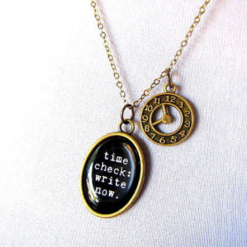 time check: write now. pendant with clock charm necklace