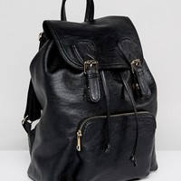 ASOS Large Buckle Front Soft Look Backpack at asos.com