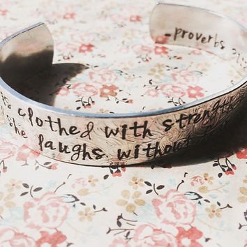 Proverbs 31:25 / She is clothed with strength and dignity and she laughs without fear of the future hand stamped floral aluminum bracelet