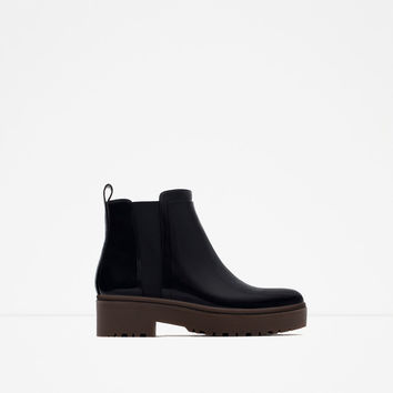 FLAT TRACK ANKLE BOOTS