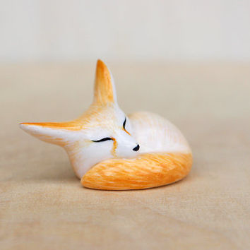 sleeping fennec fox figurine