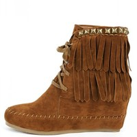 "Bamboo Mariela-10 fringe studd moccasin boots bring us back to native land! Features a lace up, pyramid studded trim with stitch detailing and fringe ends. Has a 3"" wedge heel approx. that will let you get in touch with mother nature."