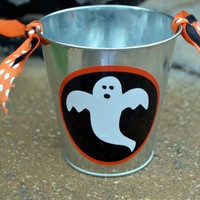 Orange black and white ghost utensil holder with coordinating ribbon