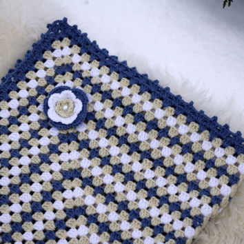 Perfect baby blanket for your little one. Made with navy blue, beige and white baby yarn. Decorated with crochet flower and pearl.