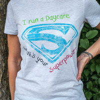 I run a Daycare. What's your Superpower? Superman inspired T-shirt. Light Gray