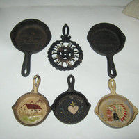 Vintage set of 6 cast iron mini skillets and trivet