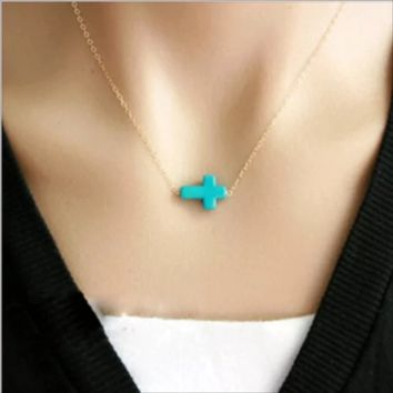 NWOT Turquoise cross with gold necklace